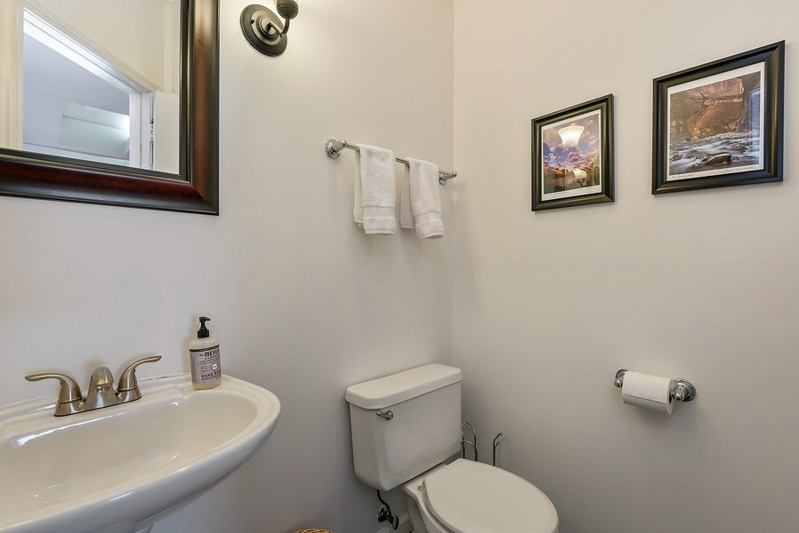 Real Estate Photography - 4822 N Winchester, 1N, Chicago, IL, 60625 - Full guest bathroom with shower (main floor)