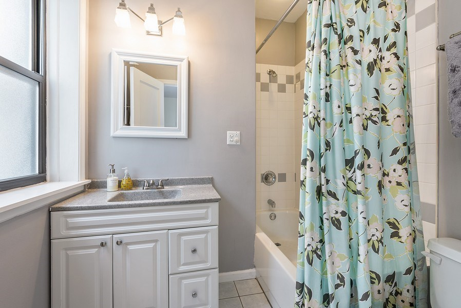 Real Estate Photography - 4822 N Winchester, 1N, Chicago, IL, 60625 - Tasteful ensuite full bathroom (2nd bedroom)