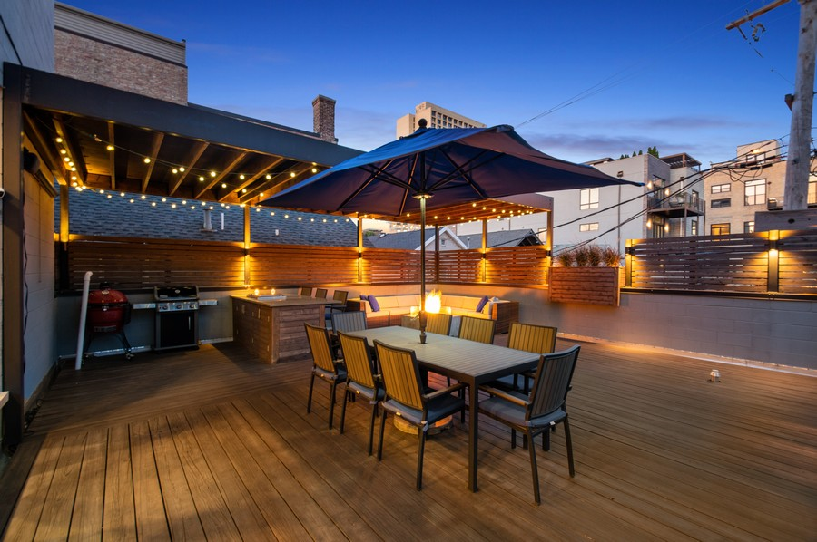 Real Estate Photography - 1113 N Ashland Ave, Unit 3, Chicago, IL, 60622 - Deck at dusk, gas line to deck