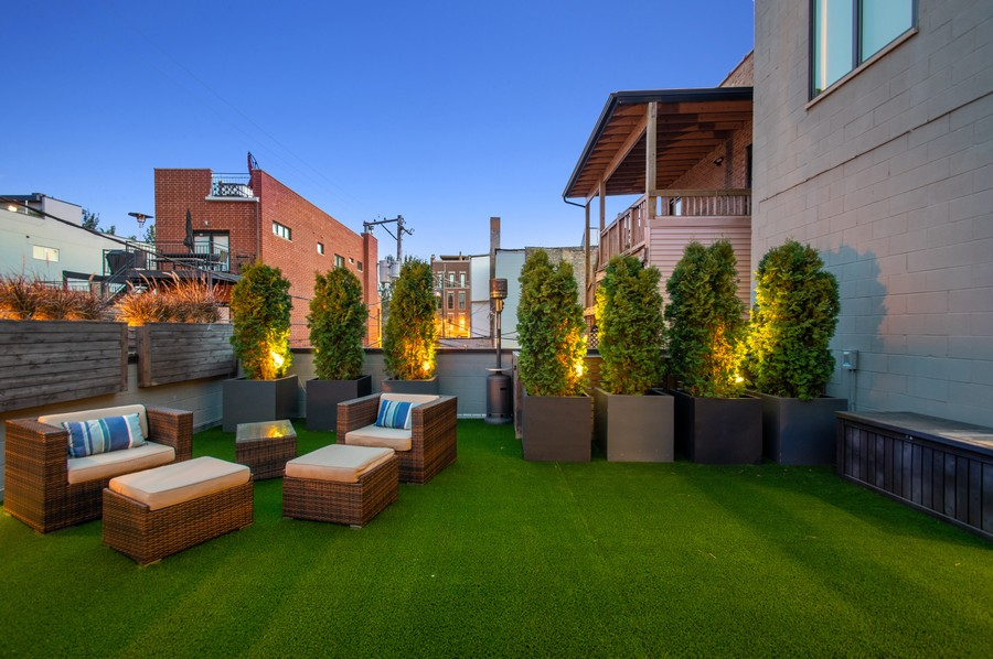 Real Estate Photography - 1113 N Ashland Ave, Unit 3, Chicago, IL, 60622 - Deck and new turf at dusk