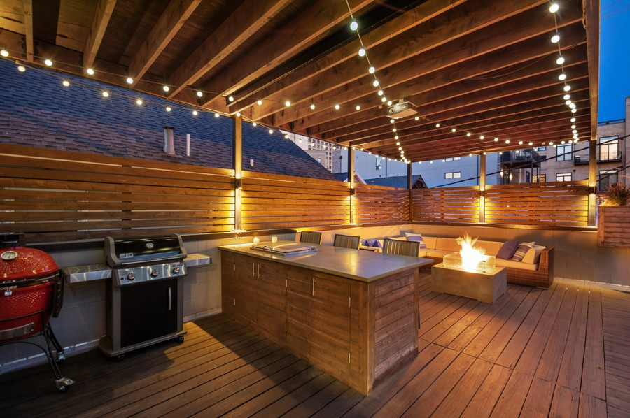 Real Estate Photography - 1113 N Ashland Ave, Unit 3, Chicago, IL, 60622 - Desk at dusk, built-in griddle and fire-pit