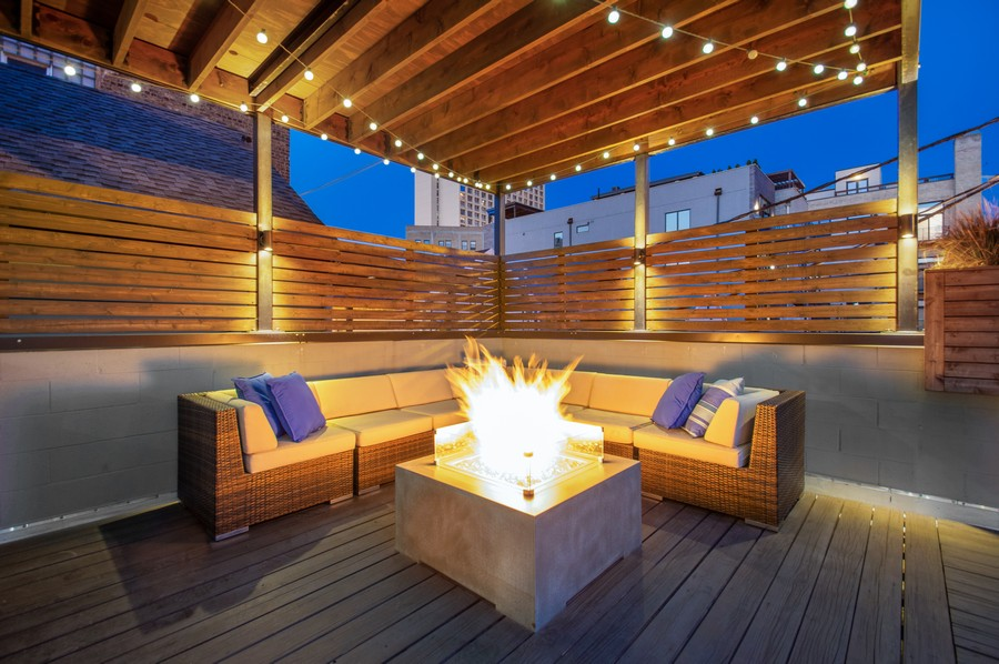 Real Estate Photography - 1113 N Ashland Ave, Unit 3, Chicago, IL, 60622 - Deck with built-in fire-pit