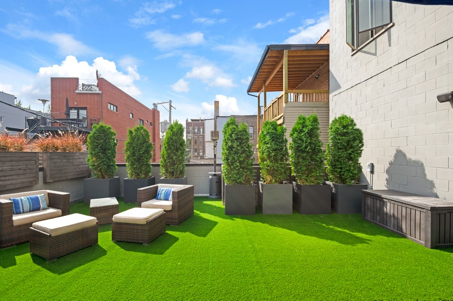 Real Estate Photography - 1113 N Ashland Ave, Unit 3, Chicago, IL, 60622 - Deck, new turf morning light