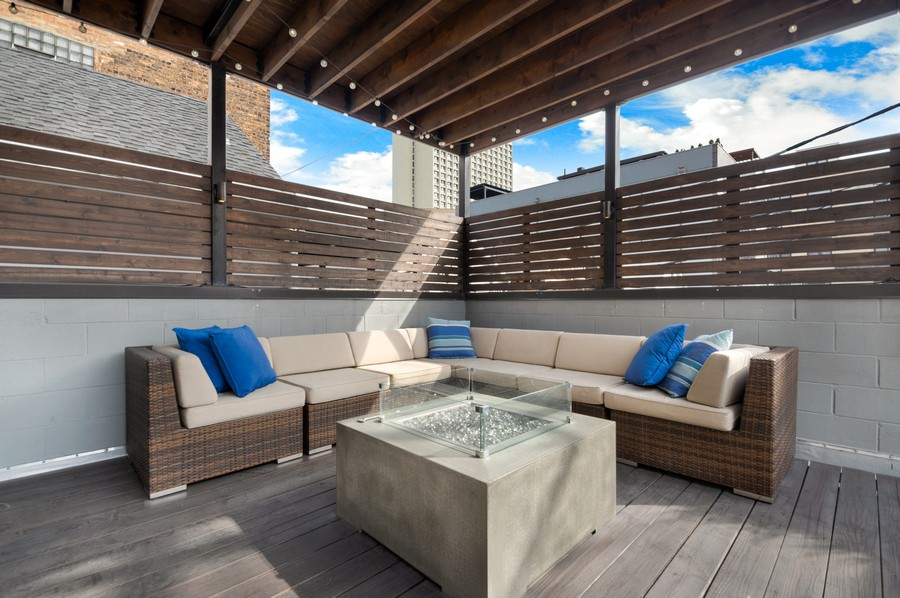 Real Estate Photography - 1113 N Ashland Ave, Unit 3, Chicago, IL, 60622 - Deck seating area in morning light