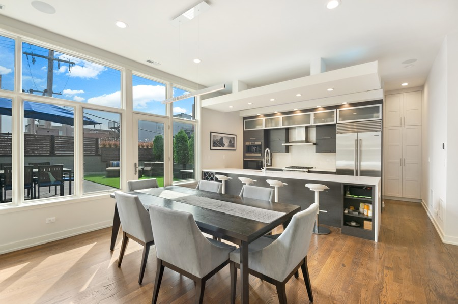 Real Estate Photography - 1113 N Ashland Ave, Unit 3, Chicago, IL, 60622 - Kitchen / dining morning light / coat and pantry c