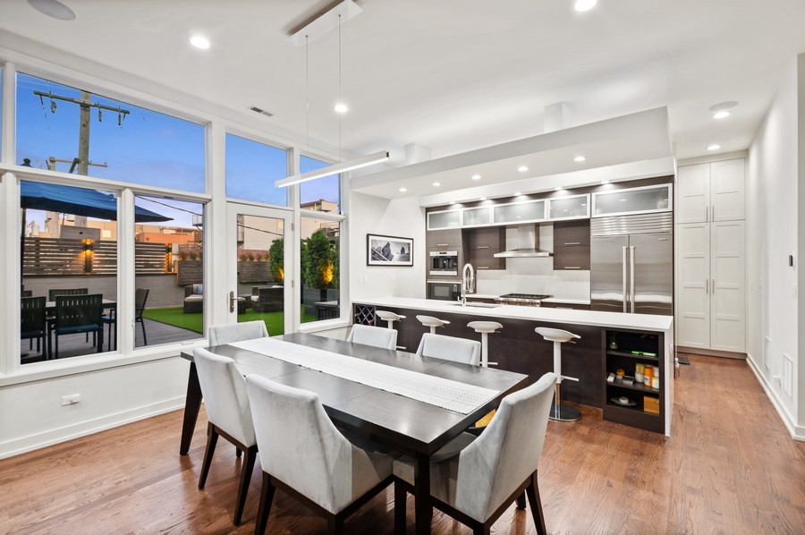 Real Estate Photography - 1113 N Ashland Ave, Unit 3, Chicago, IL, 60622 - Kitchen / dining at dusk