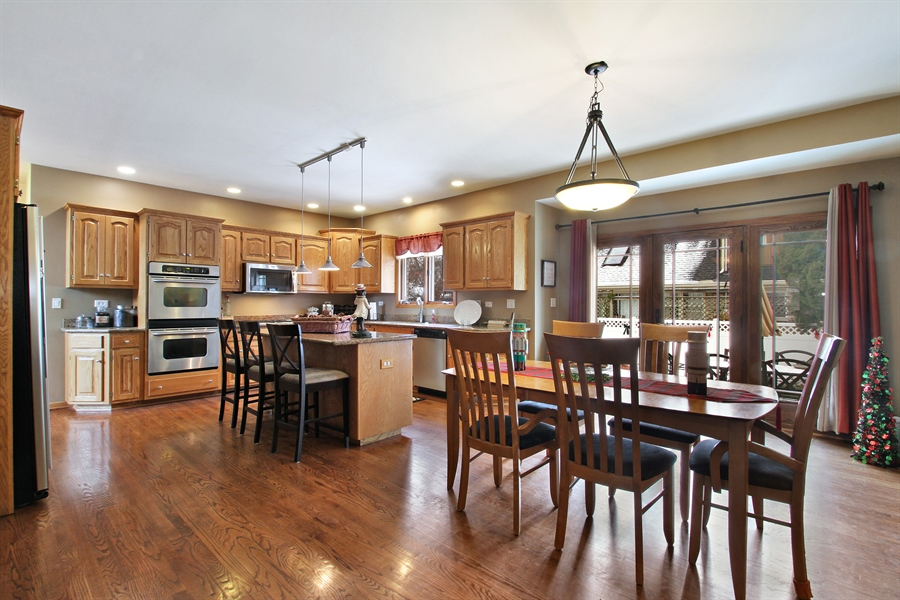 Real Estate Photography - 9140 N Washington St, Niles, IL, 60714 - Kitchen and Large Eating Area
