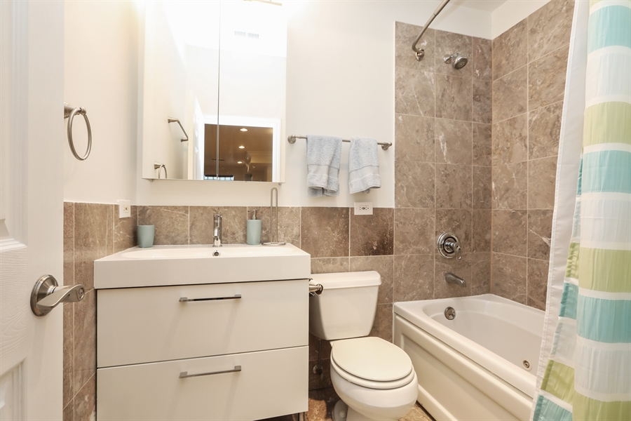 Real Estate Photography - 4744 S Forrestville, 1N, Chicago, IL, 60615 - Lower-Level 3rd Bath