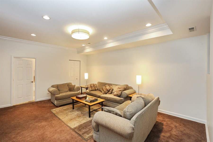 Real Estate Photography - 4744 S Forrestville, 1N, Chicago, IL, 60615 - Lower-Level Family Room