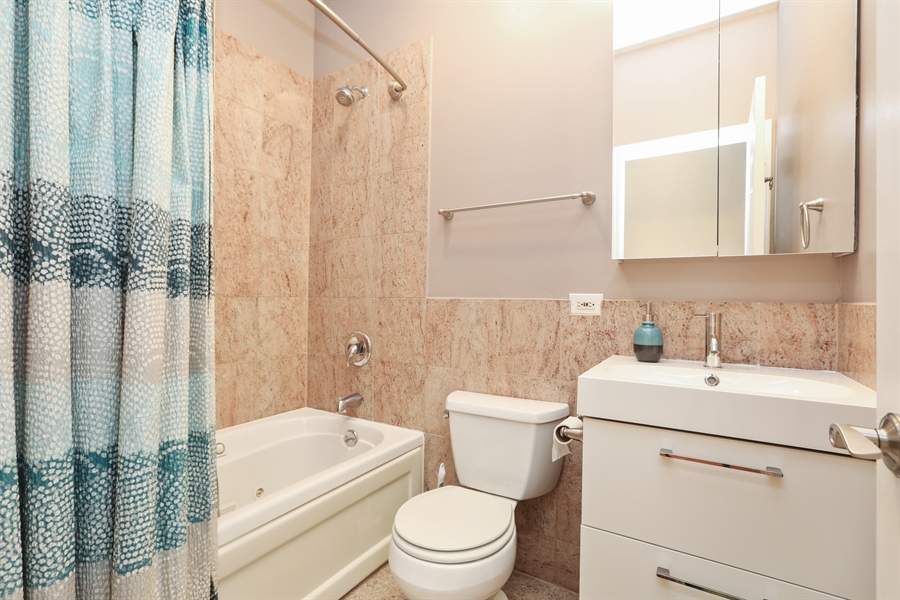 Real Estate Photography - 4744 S Forrestville, 1N, Chicago, IL, 60615 - Main-Floor Hall Bath
