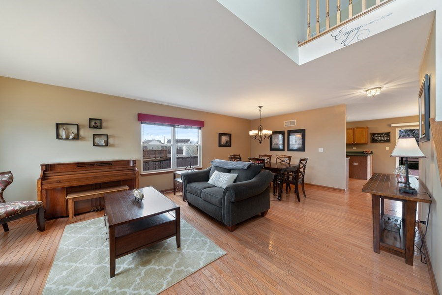 Real Estate Photography - 2003 Wedgeport Circle, Romeoville, IL, 60446 - Living Room / Dining Room