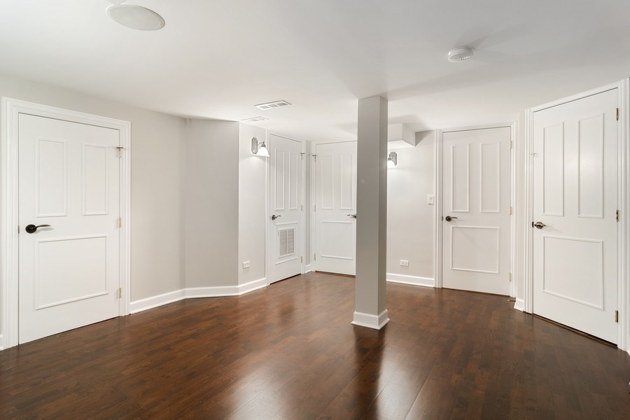 Real Estate Photography - 428 W Wellington, Unit B, Chicago, IL, 60657 - Family Room - Lower Level