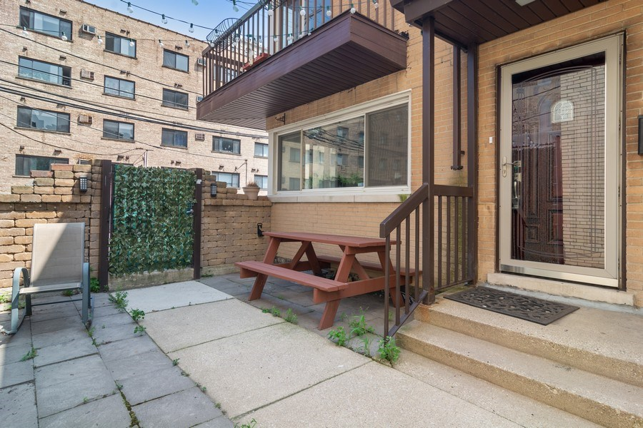 Real Estate Photography - 428 W Wellington, Unit B, Chicago, IL, 60657 - Exterior Front with Patio