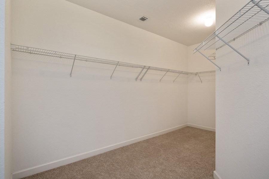 Real Estate Photography - 11441 SW 242 Lane, Homestead, FL, 33032 - Master Bedroom Closet