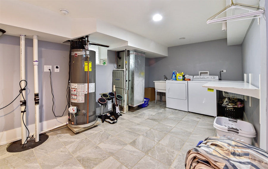 Real Estate Photography - 114 N Latrobe Ave, Chicago, IL, 60644 - Laundry Room