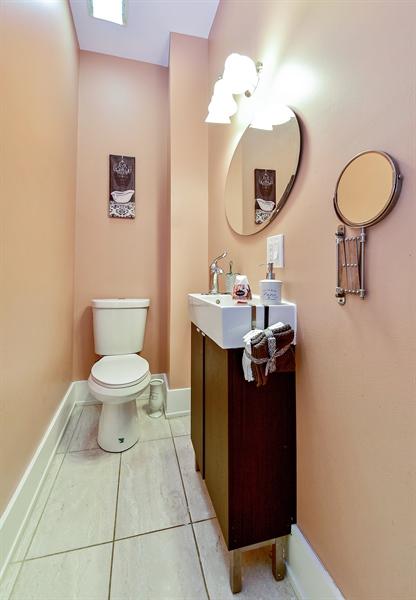 Real Estate Photography - 114 N Latrobe Ave, Chicago, IL, 60644 - Half Bath