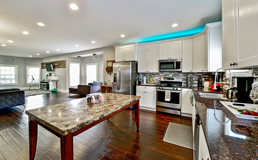 Real Estate Photography - 114 N Latrobe Ave, Chicago, IL, 60644 - Kitchen / Living Room