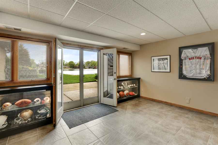 Real Estate Photography - 2090 W Touhy, Park Ridge, IL, 60068 - Lower Level to Large Patio, Yard, & Lake