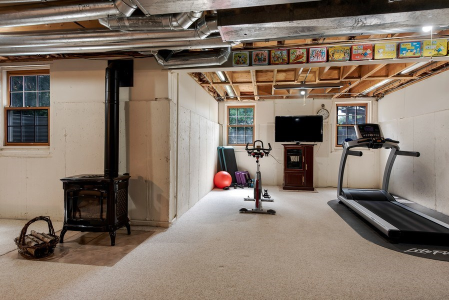 Real Estate Photography - 2126 Chandler Ln, Glenview, IL, 60026 - Lower Level with Pot Belly Stove