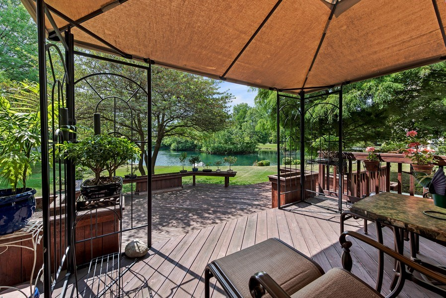 Real Estate Photography - 2126 Chandler Ln, Glenview, IL, 60026 - Covered Deck with Lake View