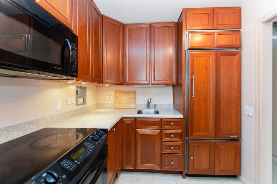 Real Estate Photography - 260 E Chestnut St, Chicago, IL, 60611 - Kitchen w/ SubZero Refrigerator