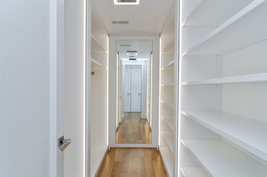 Real Estate Photography - 180 E Pearson St, 5207, Chicago, IL, 60611 - Master Bedroom Closet