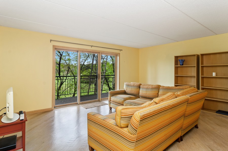 Real Estate Photography - 5225 N Riversedge Ter, Unit 212, Chicago, IL, 60630 - Living Room