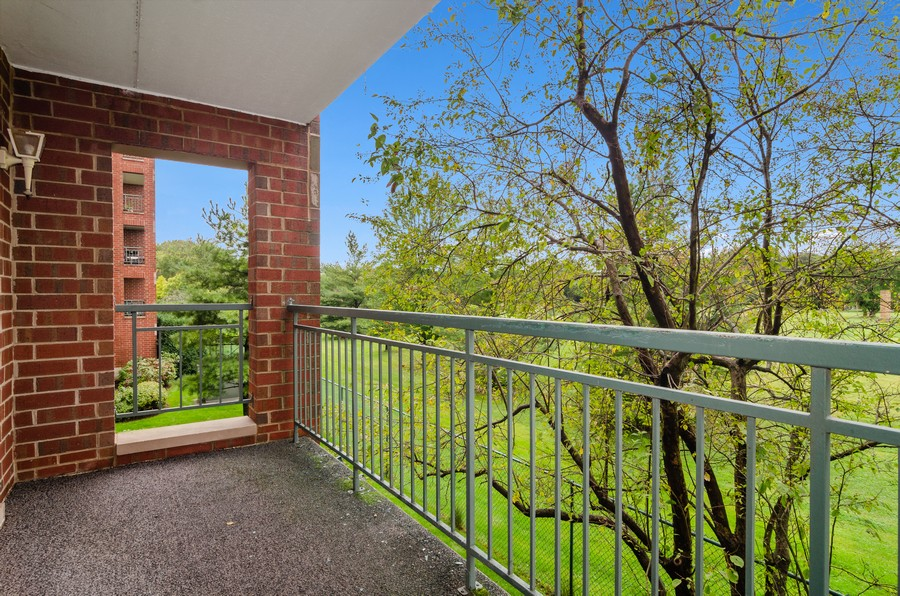 Real Estate Photography - 5225 N Riversedge Ter, Unit 212, Chicago, IL, 60630 - Terrace