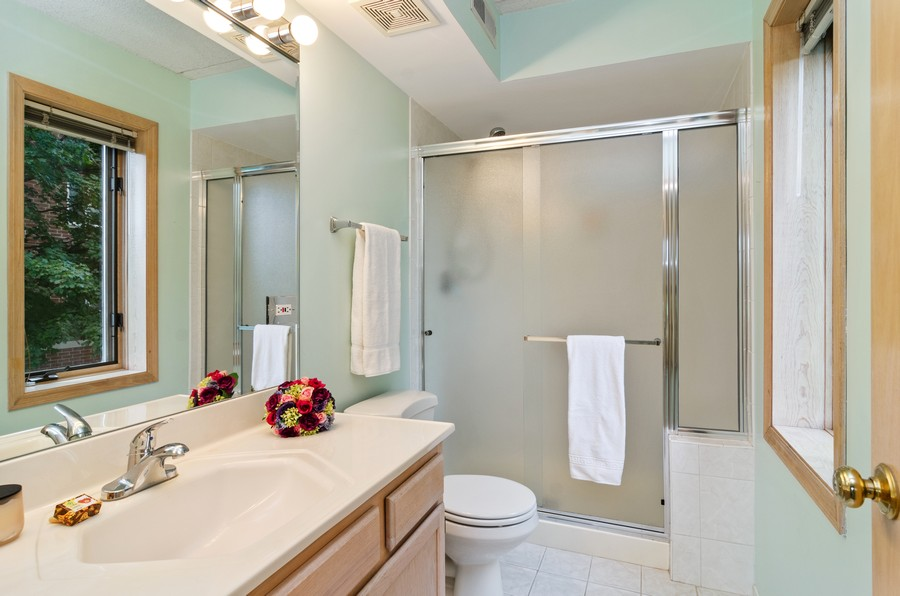 Real Estate Photography - 5225 N Riversedge Ter, Unit 212, Chicago, IL, 60630 - Master Bathroom
