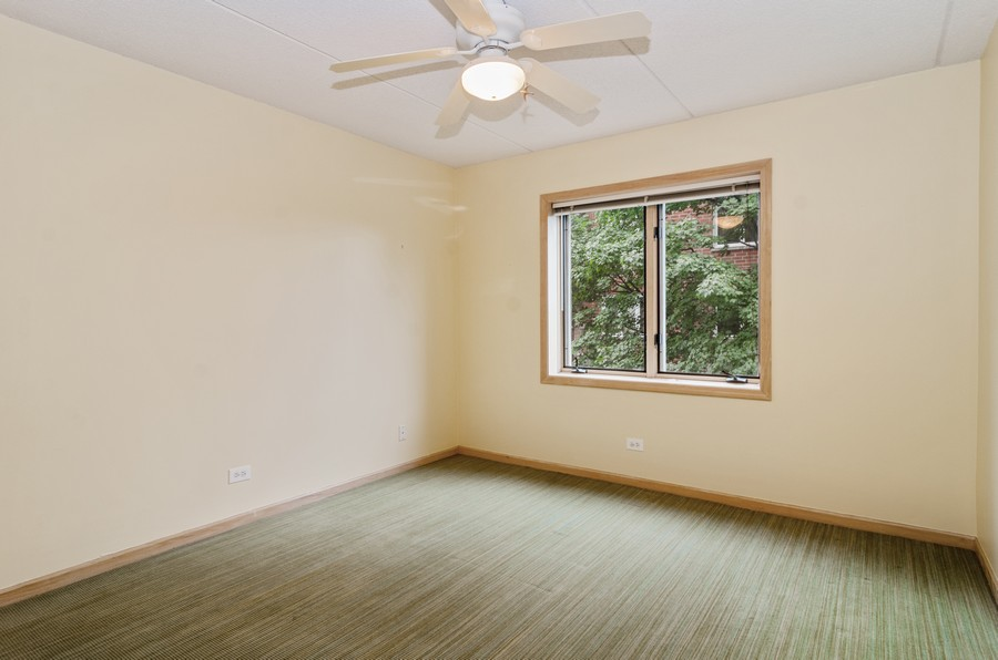 Real Estate Photography - 5225 N Riversedge Ter, Unit 212, Chicago, IL, 60630 - 2nd Bedroom