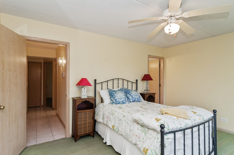 Real Estate Photography - 5225 N Riversedge Ter, Unit 212, Chicago, IL, 60630 - Master Bedroom