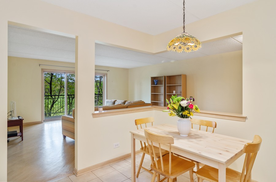 Real Estate Photography - 5225 N Riversedge Ter, Unit 212, Chicago, IL, 60630 - Kitchen / Breakfast Room