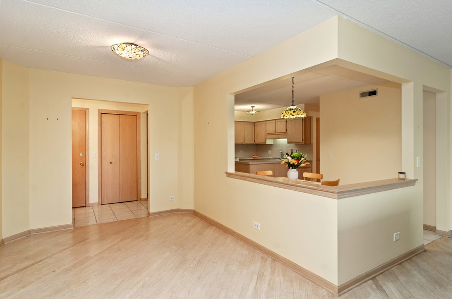 Real Estate Photography - 5225 N Riversedge Ter, Unit 212, Chicago, IL, 60630 - Dining Room