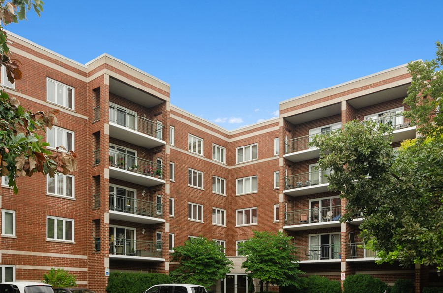 Real Estate Photography - 5225 N Riversedge Ter, Unit 212, Chicago, IL, 60630 - Front View