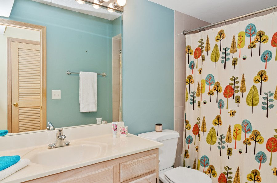 Real Estate Photography - 5225 N Riversedge Ter, Unit 212, Chicago, IL, 60630 - Bathroom