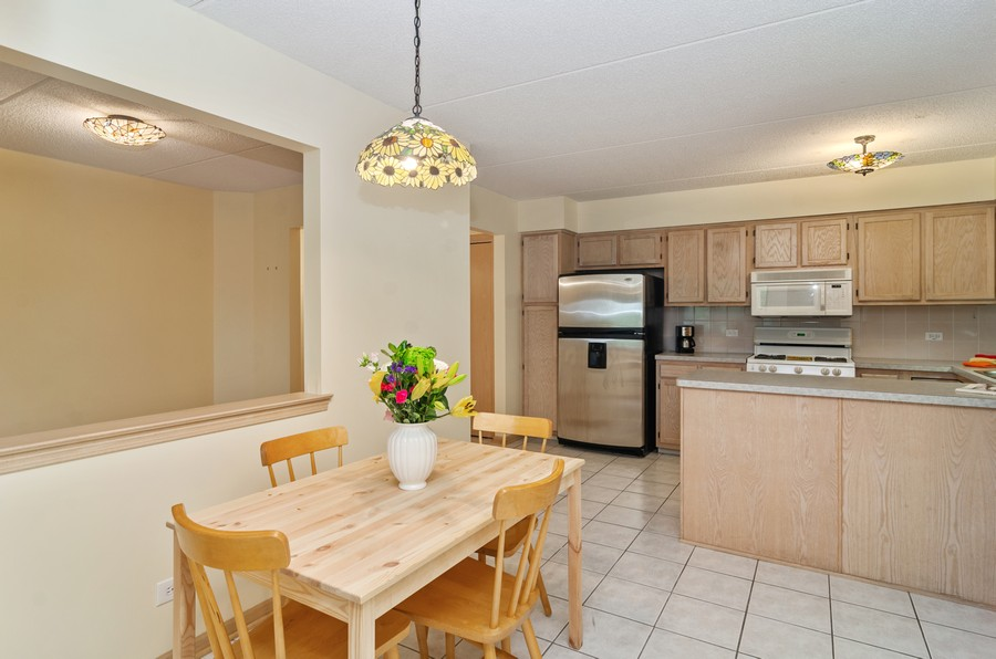 Real Estate Photography - 5225 N Riversedge Ter, Unit 212, Chicago, IL, 60630 - Kitchen / Dining Room