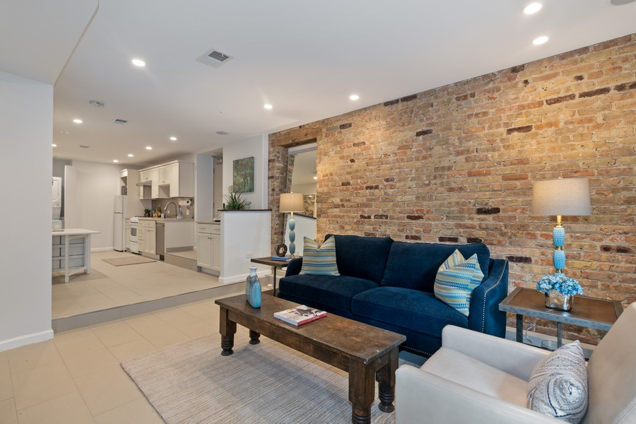 Real Estate Photography - 1234 N Dearborn St, Unit GR, Chicago, IL, 60610 - GR living room and kitchen