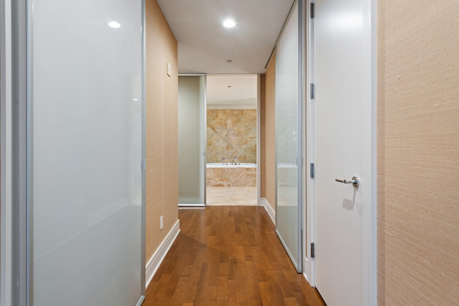 Real Estate Photography - 401 N Wabash, Unit 47G, Chicago, IL, 60611 - Master Bedroom Closet