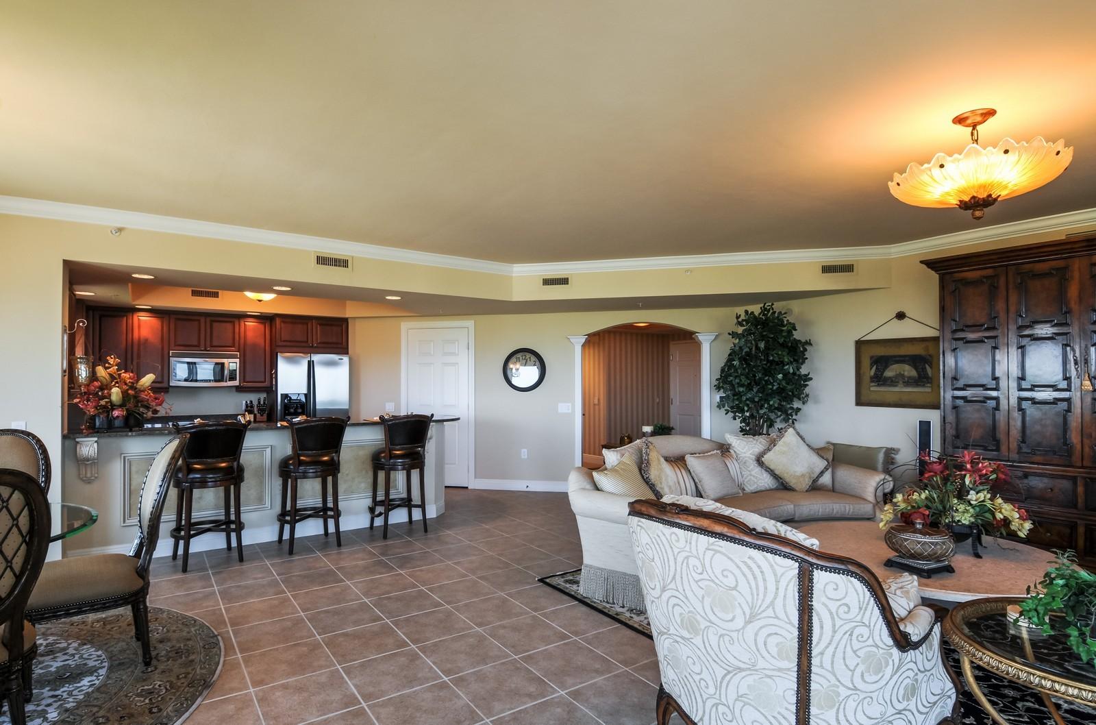Real Estate Photography - 23540 Via Veneto, Unit 1705, Bonita Springs, FL, 34134 - Kitchen / Living Room