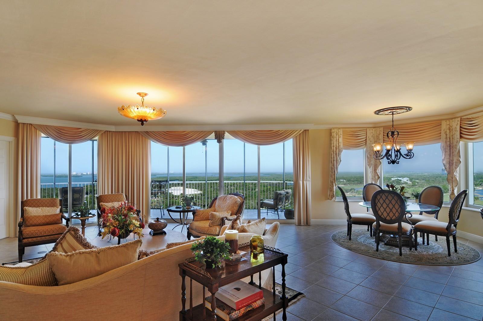 Real Estate Photography - 23540 Via Veneto, Unit 1705, Bonita Springs, FL, 34134 - Living Room / Dining Room