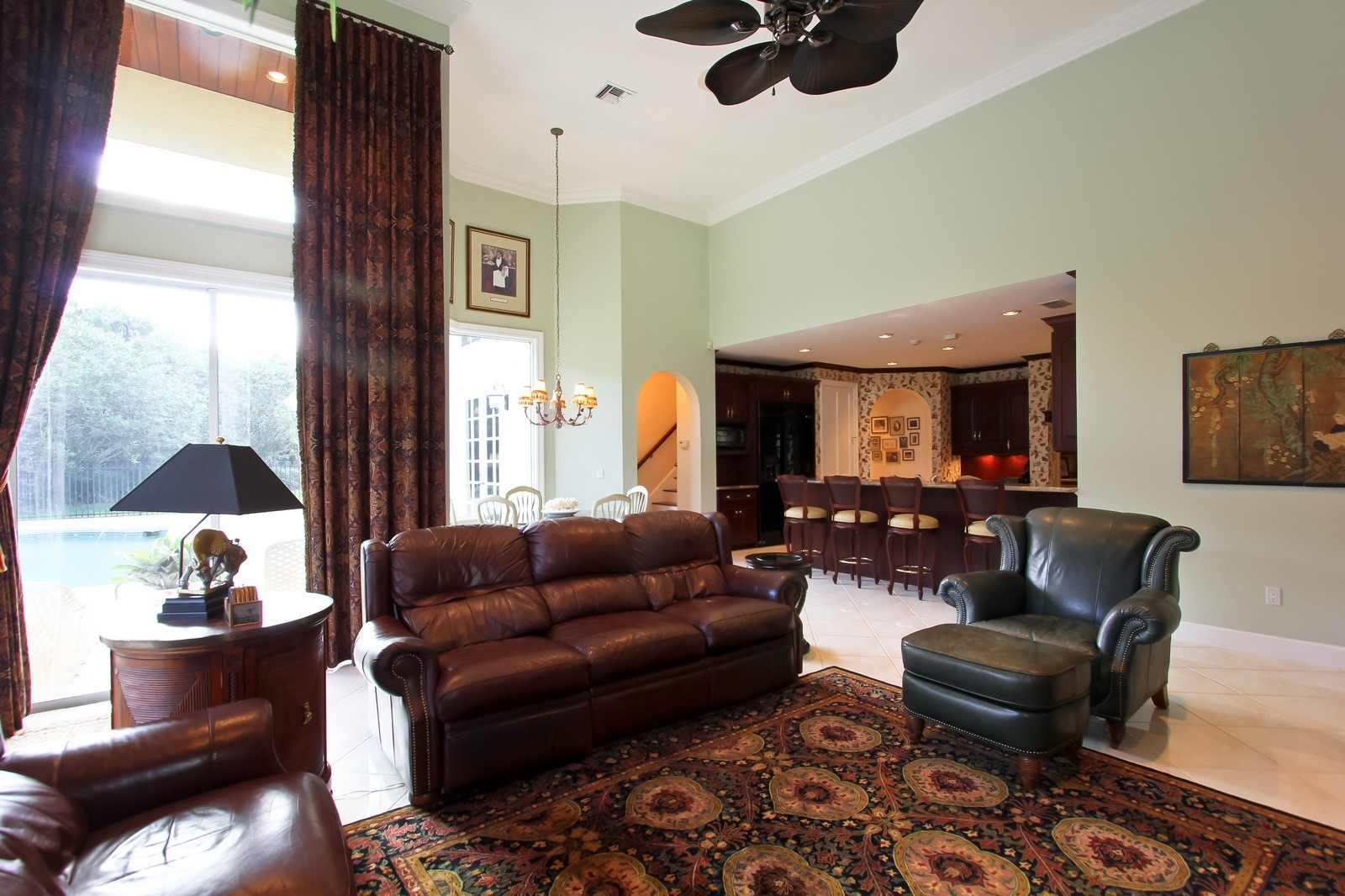 Real Estate Photography - 8725 Native Dancer, Palm Beach Gardens, FL, 33418 - Family Room / Kitchen