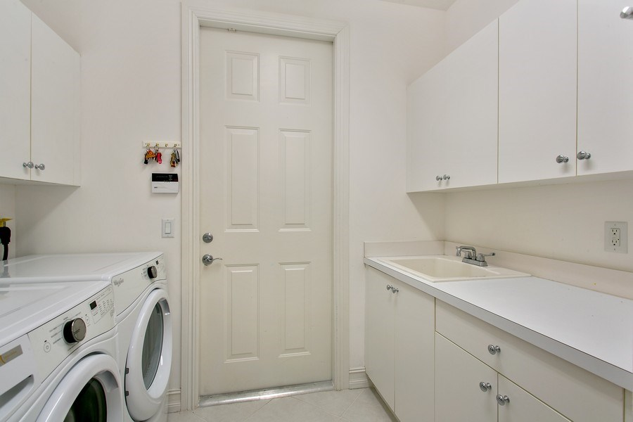 Real Estate Photography - 10327 Orchid Reserve Dr, West Palm Beach, FL, 33412 - Laundry Room
