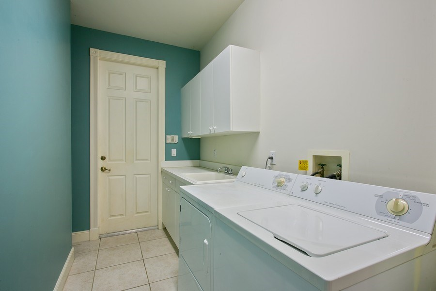 Real Estate Photography - 8990 Lakes Blvd, West Palm Beach, FL, 33412 - Laundry Room