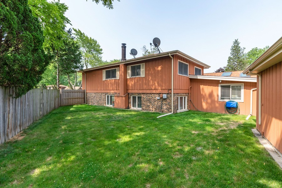 Real Estate Photography - 1714 W Stone Ave, Addison, IL, 60101 - Back Yard