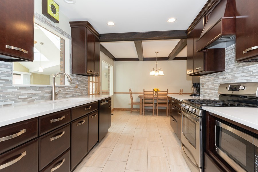 Real Estate Photography - 1714 W Stone Ave, Addison, IL, 60101 - Kitchen