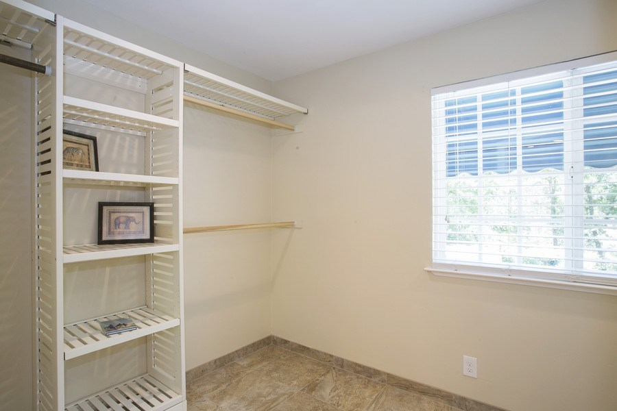 Real Estate Photography - 6385 Rainier Ave, Rocklin, CA, 95677 - Master Bedroom Closet
