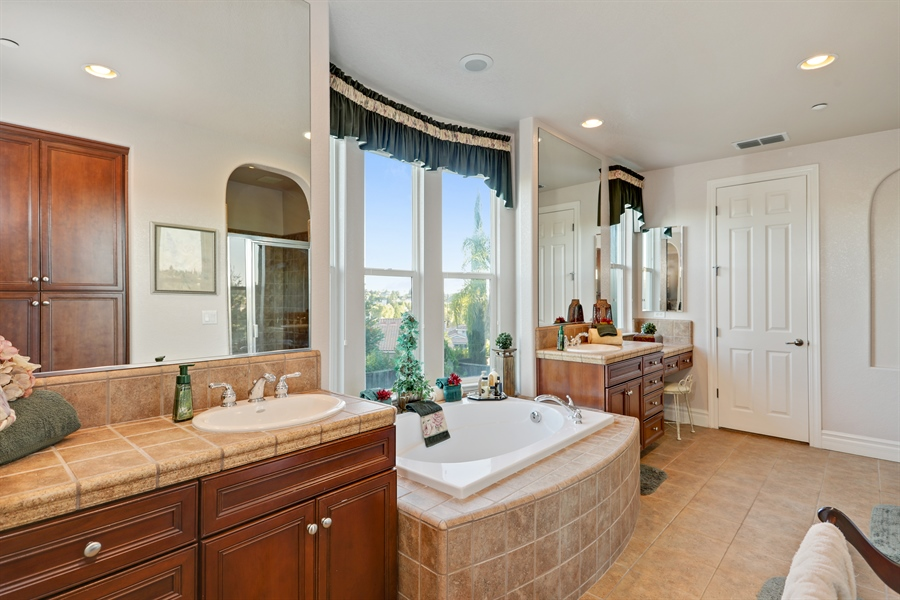 Real Estate Photography - 4420 Longview Dr, Rocklin, CA, 95677 - Master Bathroom With Dual Vanities and Soaking Tub