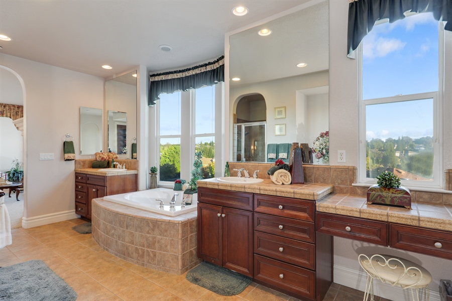 Real Estate Photography - 4420 Longview Dr, Rocklin, CA, 95677 - Master Bathroom With Panoramic View Of Backyard