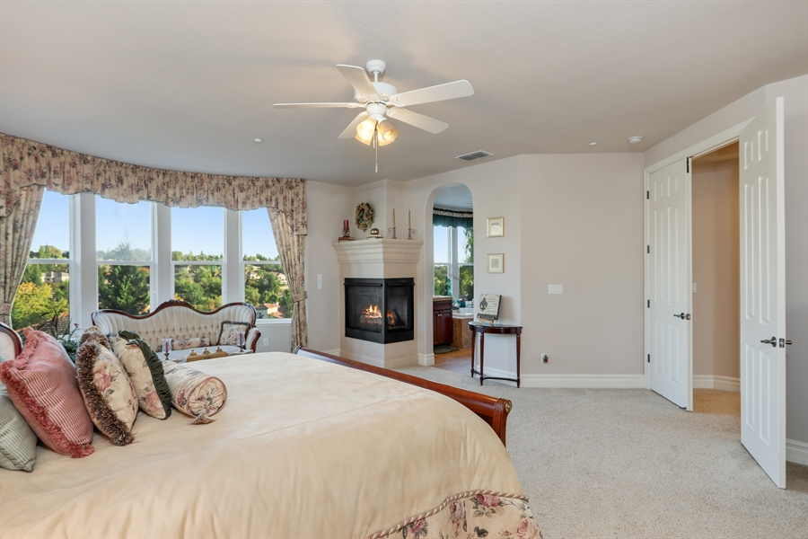 Real Estate Photography - 4420 Longview Dr, Rocklin, CA, 95677 - Spacious Master Bedroom With Romantic Fireplace