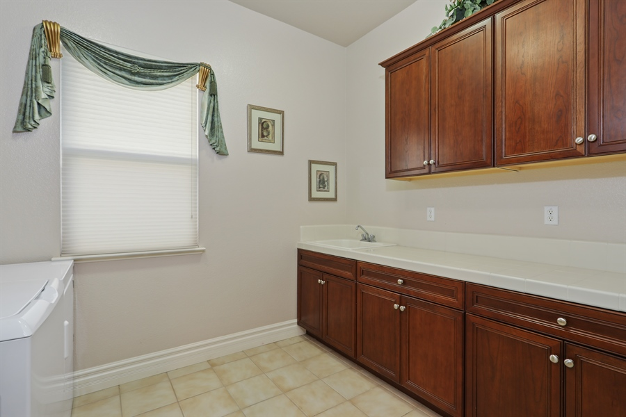 Real Estate Photography - 4420 Longview Dr, Rocklin, CA, 95677 - Spacious Laundry Room With Plenty Of Cabinet Space